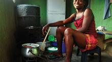 woman cooking with retrofit stove