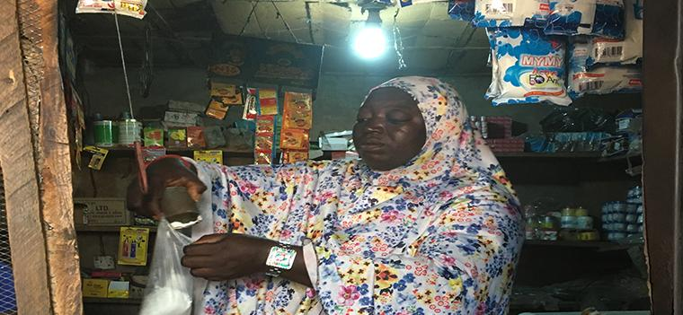 Store owner powered by solar PV mini grid. Besanti Village, Nigeria. Photo by Marjorie Araya, The World Bank